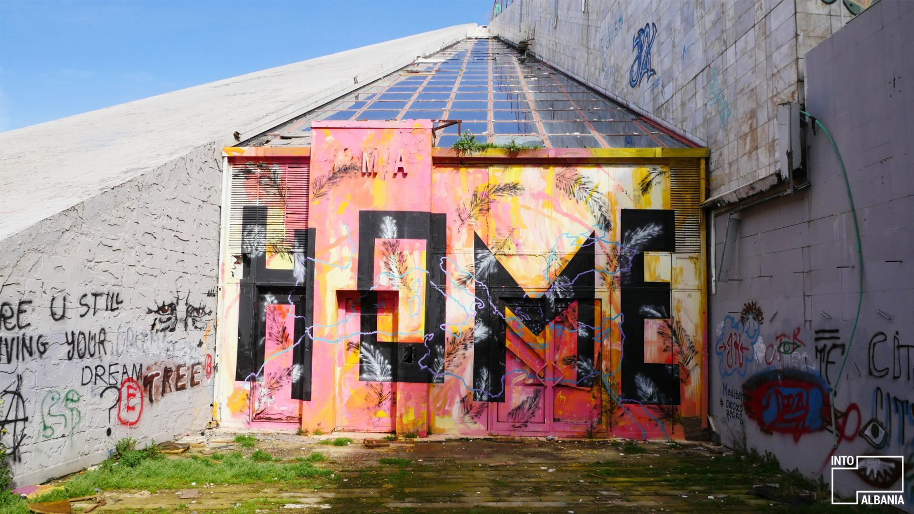 Graffiti at the Pyramid of Tirana, photo by IntoAlbania.